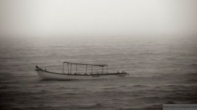 Lonely boat floating in the Arabian Sea