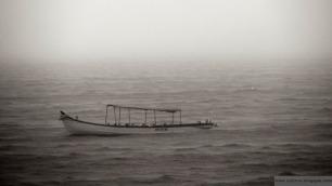Lonely boat floating in the Arabian Sea
