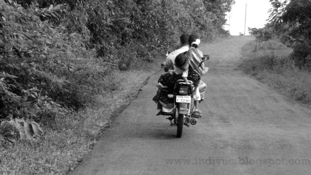 Family on a bike without helmet