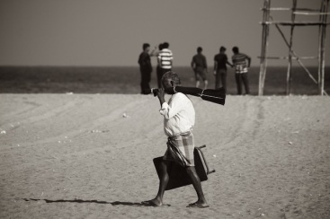 Old man and young boys on Marina beach, Chennai