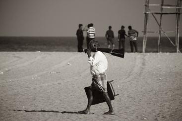 Old man and young boys on Marina beach, Chennai