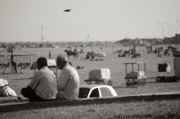 Men chatting by Marina Beach, Chennai, Tamil Nadu, India