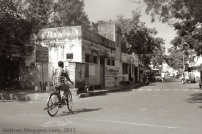 Man driving a bicycle in Chennai, India