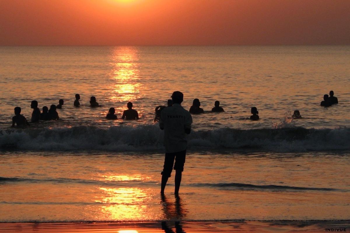 People swimming in the sea in Gokarn, India