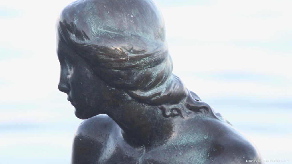 Side pose of the Little Mermaid Statue in Copenhagen