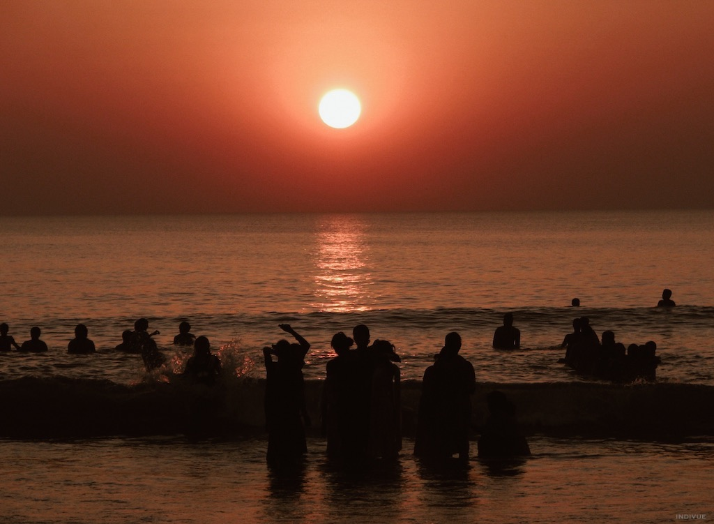 People swimming during sunset in Gokarn Beach
