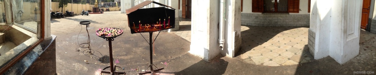 Panorama of candles burning outside a church in Chennai