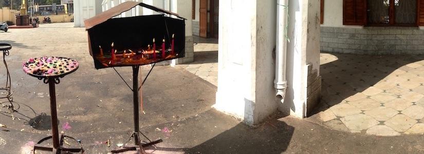 Panorama: Candles burning outside a church inChennai