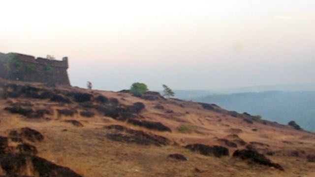 Chapora Fort wall and hill at dusk