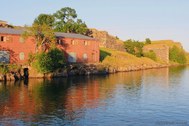 Red building in evening sun in Suomenlinna island, Helsinki